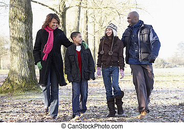 Family On Autumn Walk In Countryside