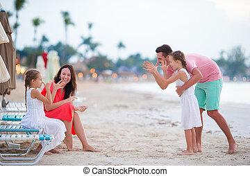 Family on beach vacation having fun