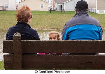 Family on Bench Looking in Different Directions