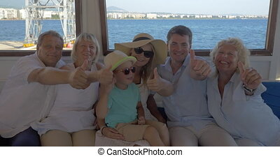 Family on board the ship showing thumbs-up