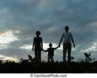 family on evening sky