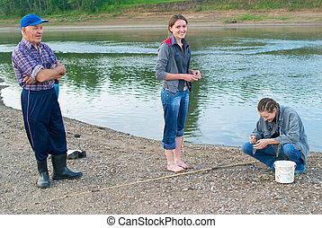 family on fishing