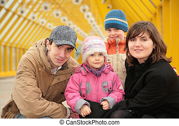 family on footbridge
