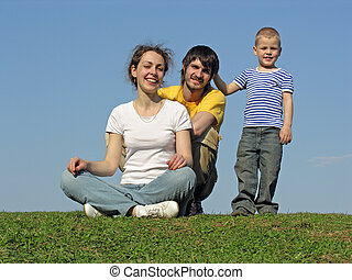family on grass sit