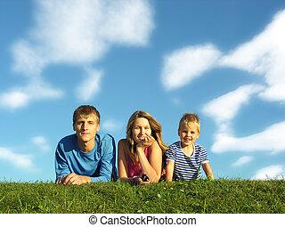 family on herb under blue sky