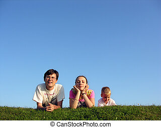 family on herb under sky 2