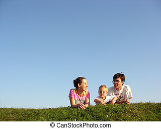 family on herb under sky