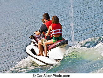Family on Jet Ski - A man and his daughters going out on a...