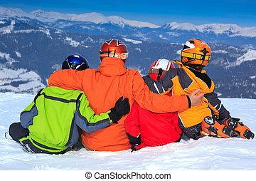 Family on mountain slope