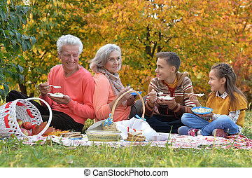 family on picnic in autumn