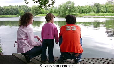 family on pond