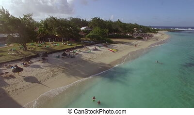 Family on resort and Mauritius aerial view