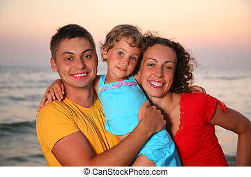 Family on sea background