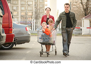 family on shop parking
