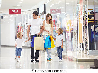 Family on shopping - A happy family makes purchases in the...