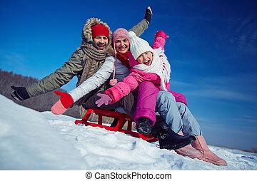 Family on sledge
