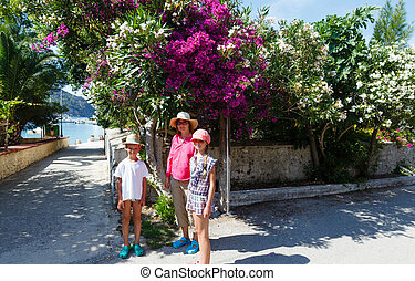 Family on street in Assos village (Greece, Kefalonia)