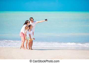 Family on the beach. Family taking photo.