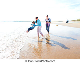 Family On The Beach - Mother and father playing on the beach...