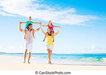 Family on the Beach - Family of four having fun on tropical...