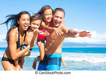 Family on the Beach - Happy Mixed Race Family of Four...