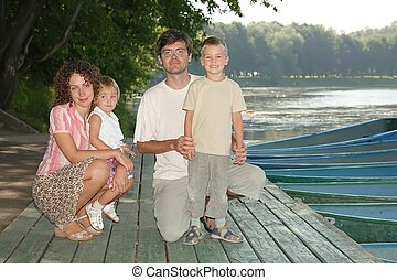family on the boat dock