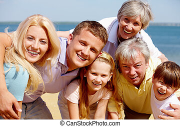 Family on vacation - Portrait of big happy family looking at...