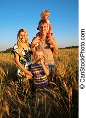 Family on wheat field