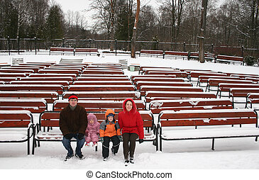 family on winter bench