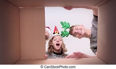 Family opening cardboard box - Happy Christmas family - mom,...