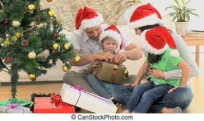 Family opening Christmas gift