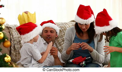Family opening Christmas presents