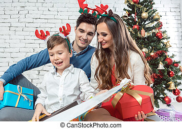 Family opening colorful Christmas presents