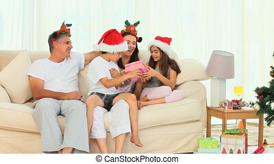 Family opening gifts during Christmas