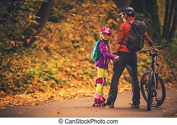 Family Outdoor Activities. Father and Daughter in the Park....