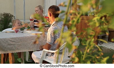 Family outdoor dining in garden