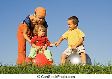 Family outdoors playing together
