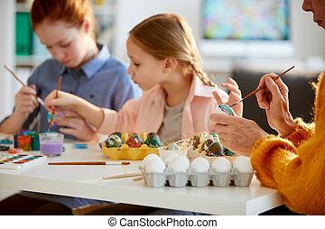 Family Painting Eggs for Easter