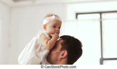 happy father playing with little baby daughter