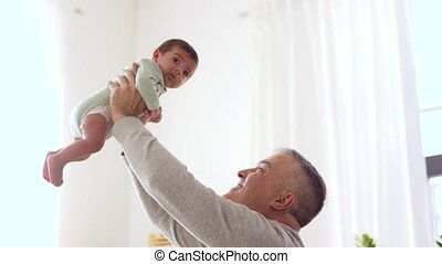 happy father with little baby boy at home - family,...