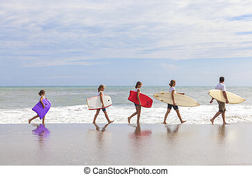 Family Parents Girl Children Surfboards on Beach - Rear view...