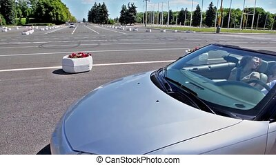 Family pass by road in cabriolet at sunny summer day