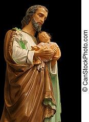 Statue of Saint Joseph holding the infant Jesus.
