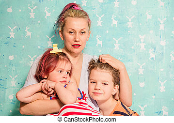 Family photo. Mom with children.