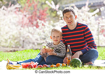 family picnic - happy family of father and son having picnic...