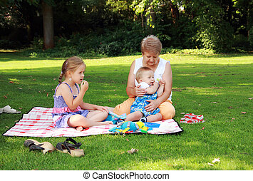 Family picnic - Kids have a small picnic with grandma
