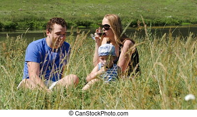 Family picnic outdoor on a bright summer day