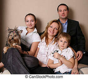 Family - Mum, daddy, two children and yorkshire terrier on a...