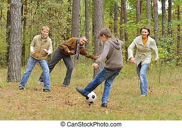 Family play football forest