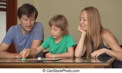 Family play table games at home during the quarantine. Self-isolation with kids